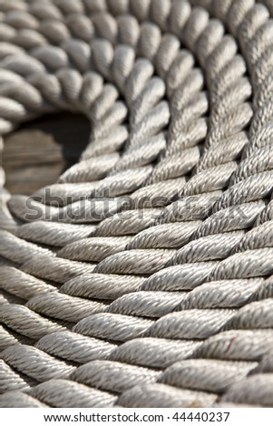 coil of marine rope, closeup background image - stock photo