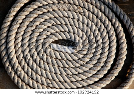 coil of marine rope detail in marina port