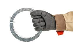 Coil of perforated metal mounting tape in worker hand in black protective glove and brown uniform isolated on white background