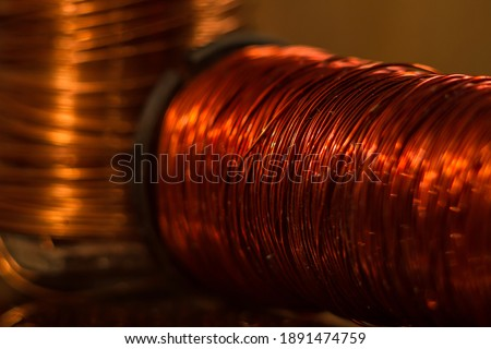 Coil of red copper wire close up. A macro shot of an inductor. ストックフォト ©