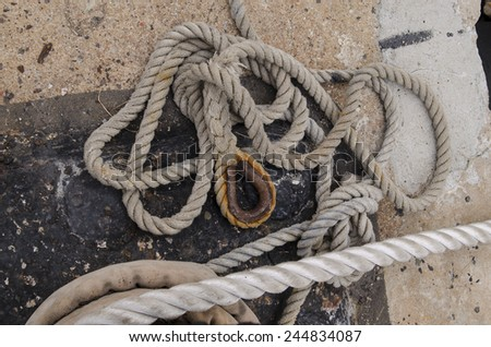 coil rope with hook on concrete floor #244834087