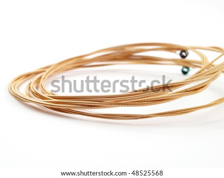 Coiled acoustic guitar strings on white background #48525568