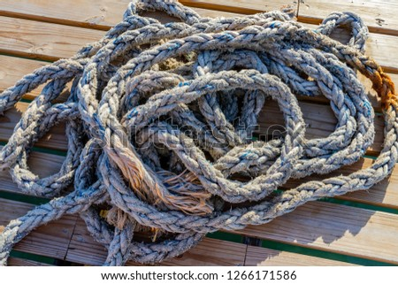 Coiled rope on jetty  #1266171586