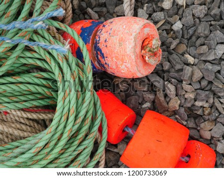 Coils of used rope used for lobster traps lying on the ground in a marina