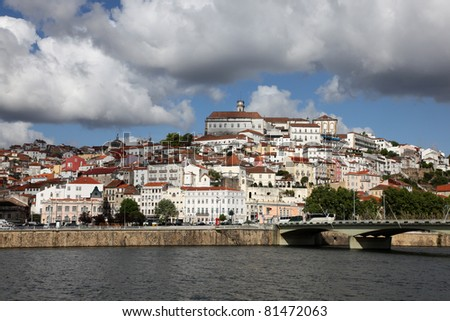 Coimbra cityscape across the Mondego river. Coimbra is an historic university city in Portugal. The University was founded in 1290 and is one of the oldest in the world.