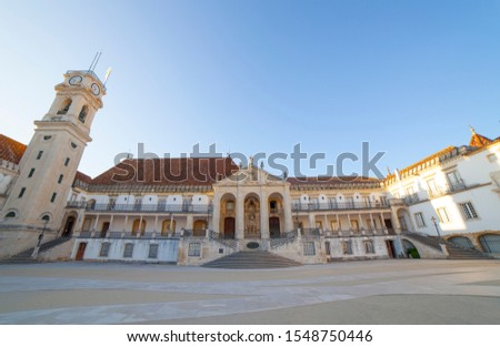 Coimbra, Portugal - Sept 6th 2019: Old Royal Palace facade and clock tower at University of Coimbra Courtyard. Blue sky background ストックフォト ©