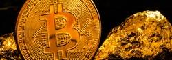 Coin bitcoin next to pieces of gold