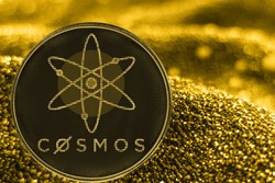 Coin cryptocurrency cosmos and gold fabric background. atom logo.