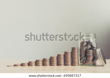 Coin in glass bottle with money stack step up growing growth saving money, Concept financial business investment, Copy space for your text