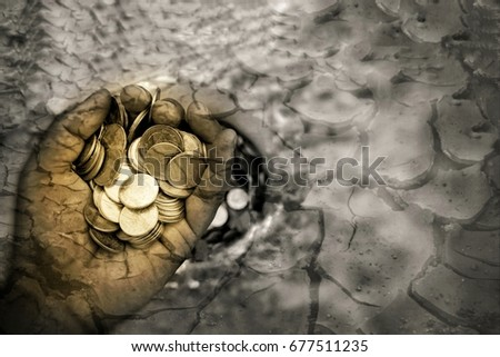 coin in hand on arid land background concept poor Foto d'archivio ©