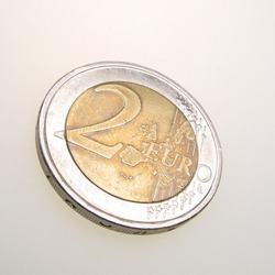 coin of denomination two euro on  white background,  close up