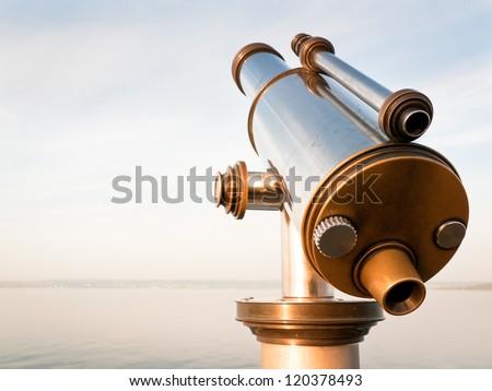 coin-operated binoculars at a lake