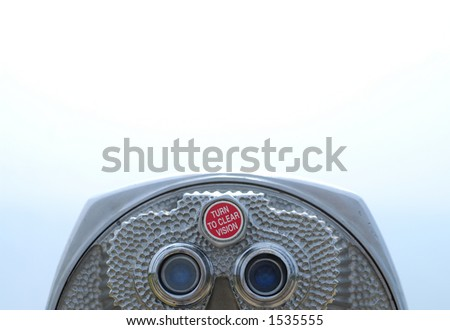 Coin operated binoculars centered bottom landscape with room for copy