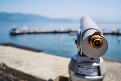 Coin Operated Spyglass viewer next to the waterside promenade looking out to the bay.