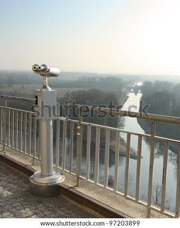 Coin operated telescope looking out Canal Vltava - Labe in Melnik, Czech Republic
