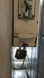Coin operated washing machine, old condition, dilapidated, rust, corrosive