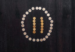 Coin Pause. Media control symbol Pause done by coins. Money Pause.