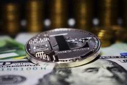 Coin physical Litecoin LTC, background from banknote and golden coins.