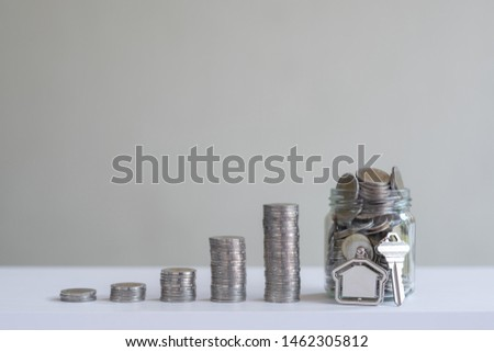 Coin piles arrange into growth chart on white background, finance and business concept, copy space