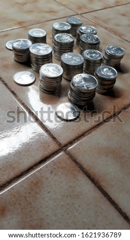 Coin piles of 100 and 200 Rupiah of Republic of Indonesia