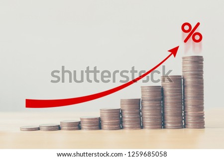 Coin stack step up graph with red arrow and percent icon, Risk management business financial and managing investment percentage interest rates concept
