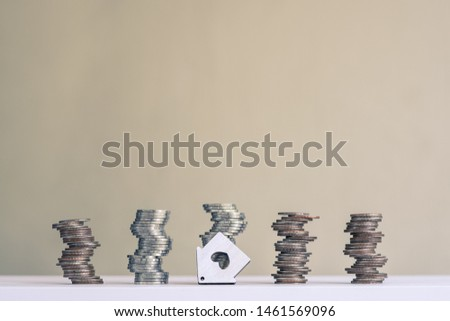 Coin stacks arranged into growth chart on white background, finance and business concept, copy space