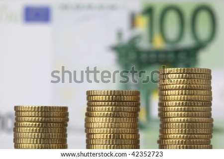 coin stacks with 100 euro banknote