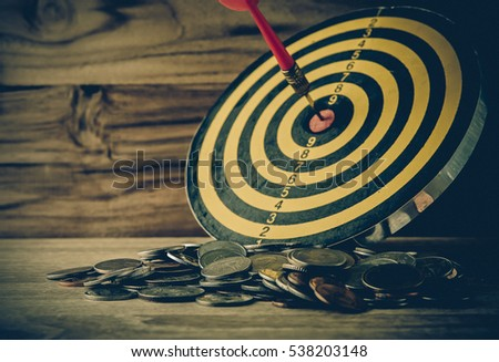 coin with dart board on the...