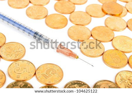 Coin with syringe