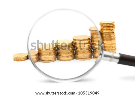 Coins and a magnifier. On a white background.