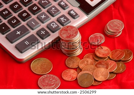 Coins and Calculator on red