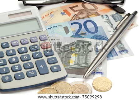 Coins and cash with pen along with glasses and pocket calculator on a white background