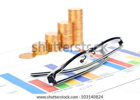 Coins and eyeglasses on trend graph
