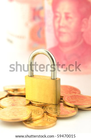 Coins and lock isolated on 100 RMB background