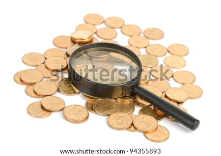 Coins and magnifier
