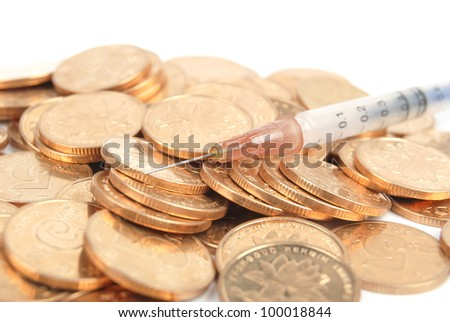 Coins and syringe