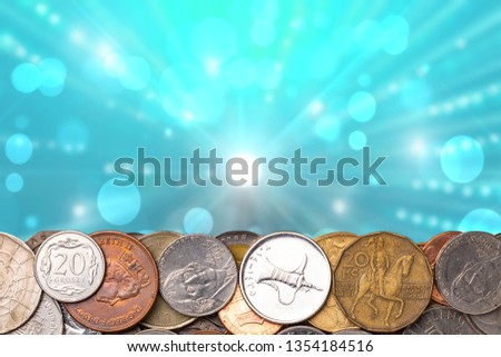 Coins background. Closeup of coins border built of a lot of money from different countries of the world over abstract blue explosion of capital. Finance, capital banking and investment concept. Macro.