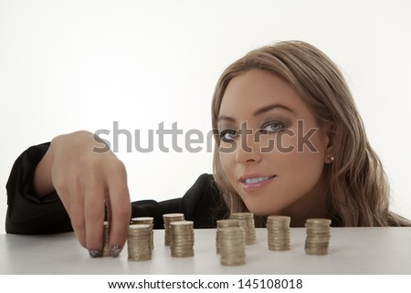 Coins counting woman smiling shot in the studio on while background