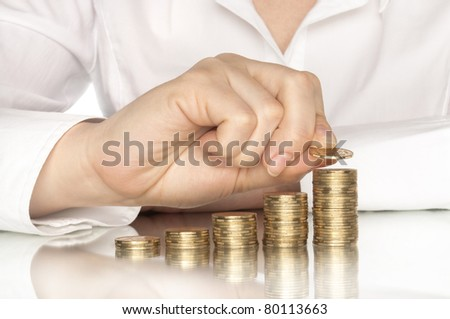 coins diagram with hand and reflection