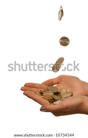 Coins fall in to the girl hands. Isolate on white - stock photo