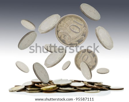 Coins falling and pile of coins