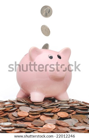Coins falling into a piggy bank
