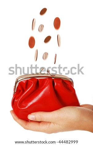 Coins falling into red purse isolated on white