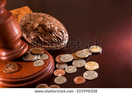 Coins from around the world, bas-relief of a lion and a hammer of auctioneer