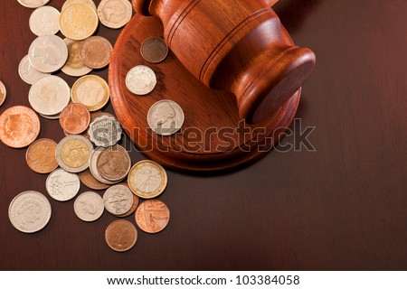 Coins from different countries and gavel