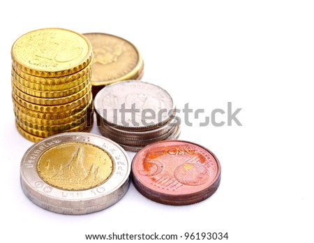 coins from many countries on white background