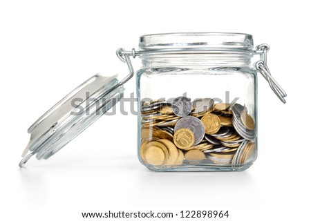 coins in a glass jar with blank label on white background