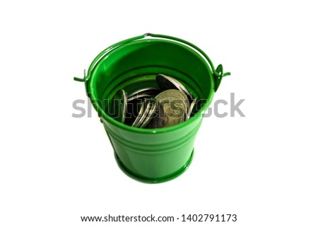 c142f0e2f79485 coins in a green bucket isolated on white background. Ukrainian pennies.  #1402791173