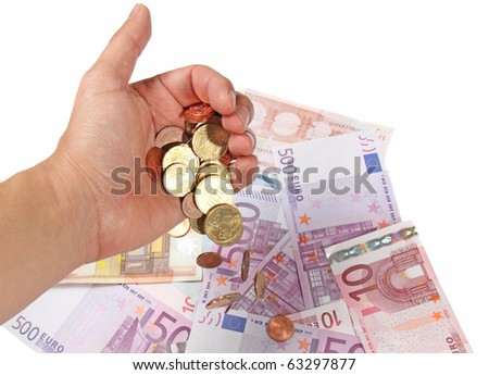 Coins in a hand and euro banknotes - stock photo