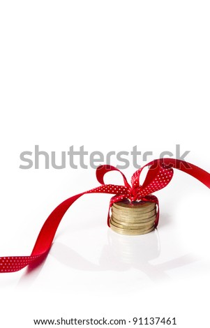 coins in a ribbon, contrast of money and feelings